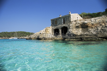 stone dwelling overlooking bay cala mondrago