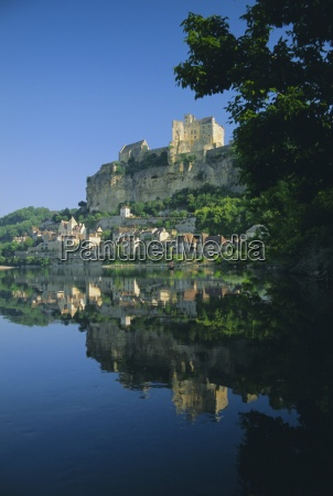 village and castle reflected in the