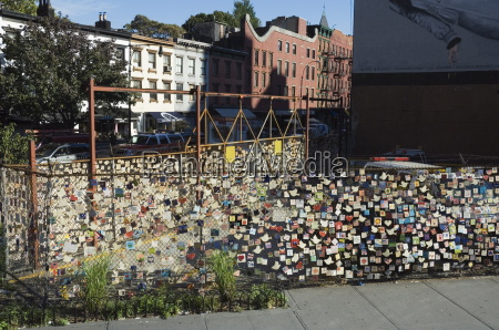 911 messages on tiles on fence