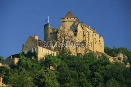 castle perched on hill above the