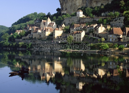 village reflected in the water of