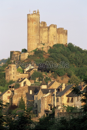 the castle towering above village houses