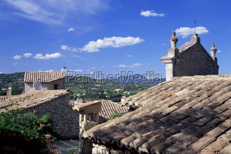 view over tiled roofs in upper