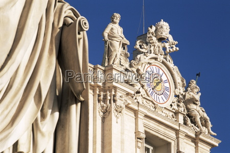 clock adorning facade of st peters