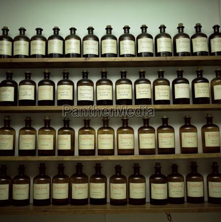 shelves of old essence bottles parfumerie