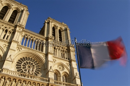 french flag and notre dame de