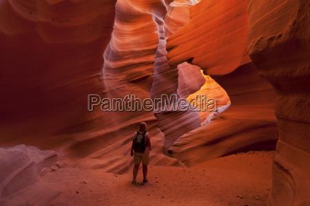 female tourist hiker and sandstone rock