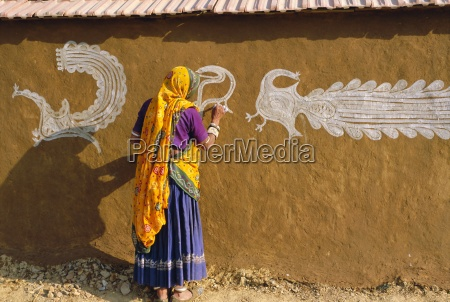 woman decorating her house with traditional