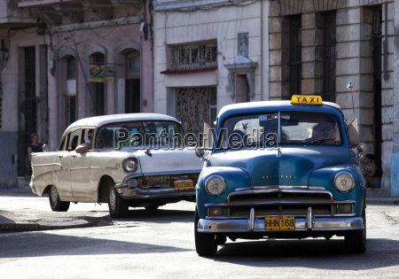vintage american car taxi on avenue