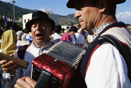 people traditionally dressed singing during the