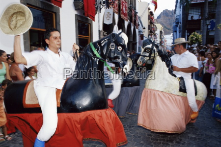 wooden horses on parade during the