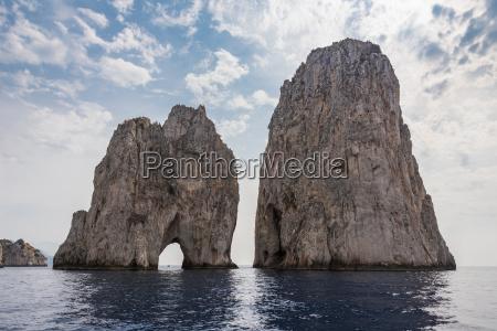 faraglioni rocks at capri island coast