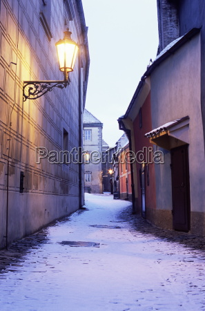 snow covered 16th century cottages on
