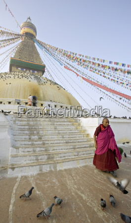 buddhist monk descends the steps of