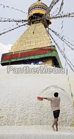 repainting boudha the buddhist stupa at