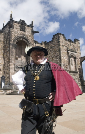 castle steward in traditional dress provides