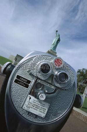 long range binoculars and statue of