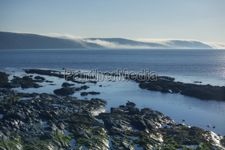 mist rolling from the hills at
