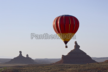 hot air balloon and rock formations