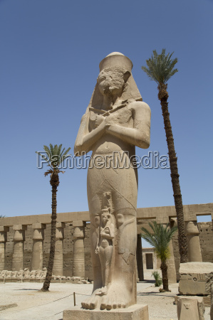 statue of ramses ii with his
