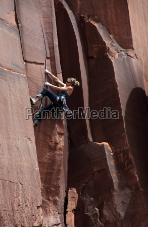 a rock climber tackles an overhanging