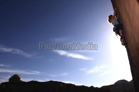 a rock climber tackles an overhanging