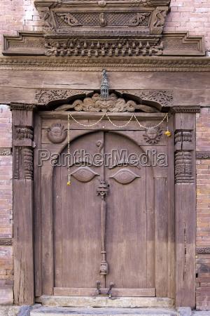orate wooden door in the hanuman
