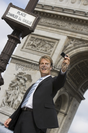 business man taking picture paris france