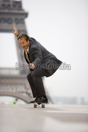 business man on skateboard eiffel tower