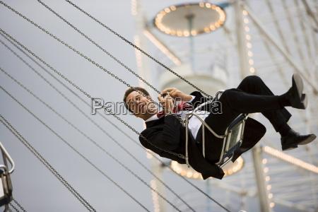 man on ride at fair paris