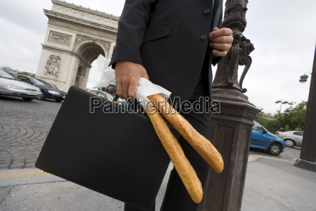 business man with bread paris france