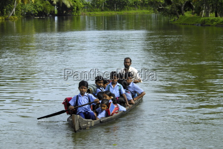 school children in a country boat