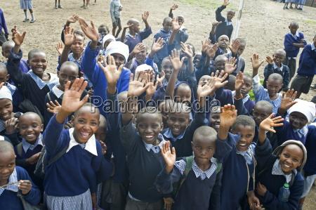 school children waving langalanga primary school
