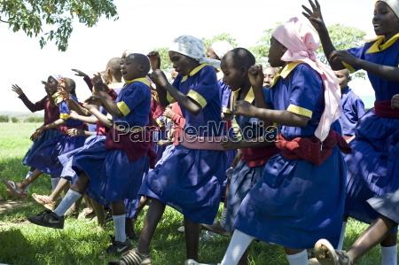 schoolgirls performing kikuyu celebratory dance ndogo