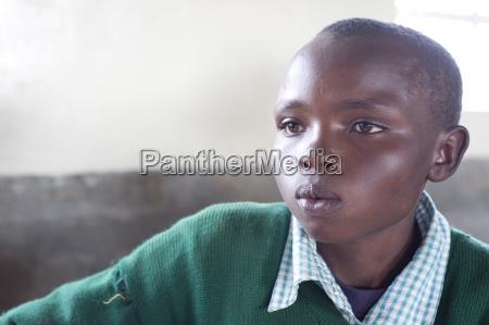 schoolboy in school uniform concentrating ngeteti