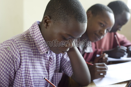 schoolboys working in class ngumo primary