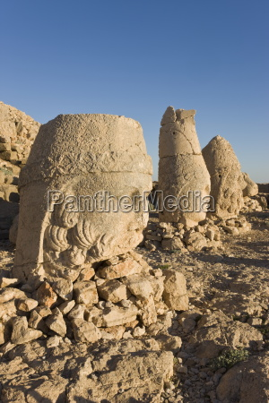 ancient carved stone heads of the