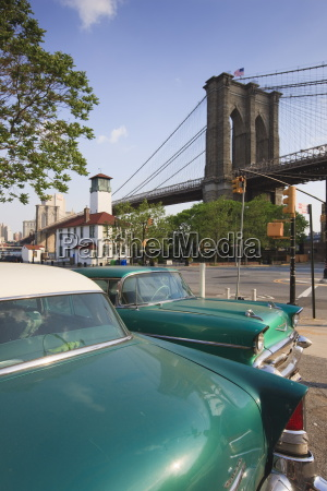 two 1950s cars parked near the