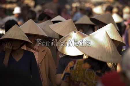 women wearing conical hats binh tay