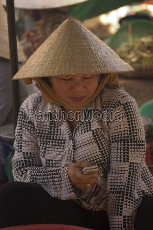 woman wearing conical hat binh tay