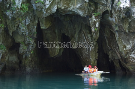 tourists in paddle boat at entrance