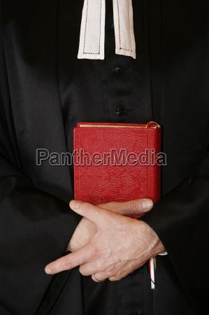protestant minister holding bible paris ile