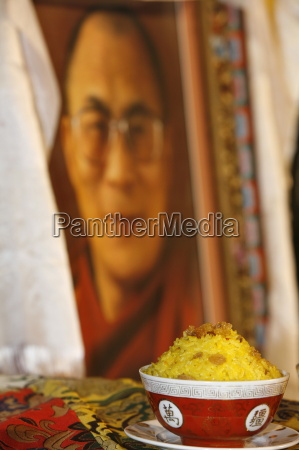 offering and picture of the dalai