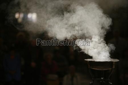 incense burning in paris cathedral paris
