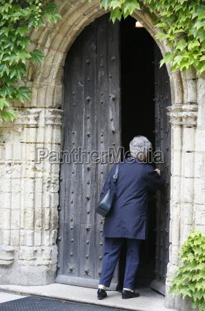 woman walking into saint pierre de