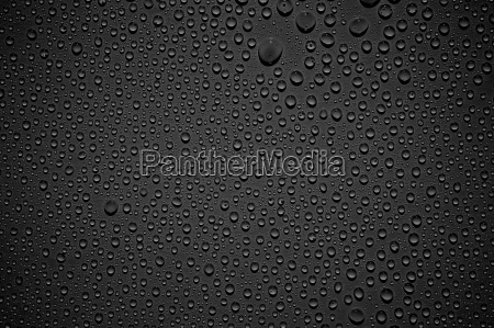 black background with shiny drops of