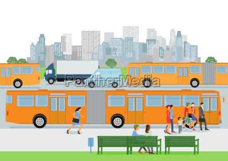 bushaltestelle mit linienbus und fahrgaesten