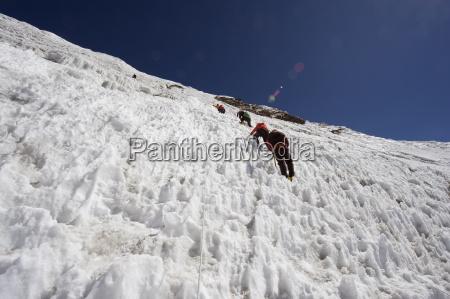 climbers on an ice wall island