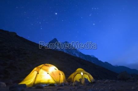 illuminated tents at island peak base