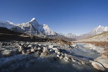 mountain stream and ama dablam 6812m